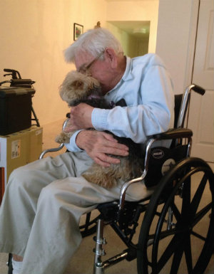 Arthur, with his beloved Yorkshire Terrier Charlie, from the third prize-winning story