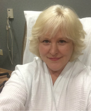 Amy Berman prepares for her single, larger dose of image-guided radiation therapy.