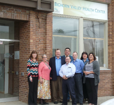 From left, Bighorn Valley Health Center (BVHC) board members Luella Brien and Cari McCleary; U.S. Sen. Jon Tester of Montana; Bighorn County Commissioner Sidney Fitzpatrick; BVHC Medical Director Earl Sutherland (front); BVHC CEO David Mark, MD; and board members Carlene Old Elk and Alma McCormick.