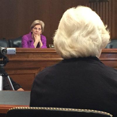 U.S. Sen. Elizabeth Warren, D-Mass., listens intently as Amy Berman testifies before the Senate Special Committee on Aging.